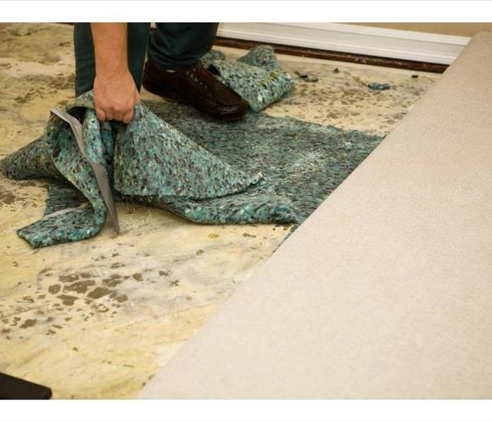 carpet being removed form floor after water damage