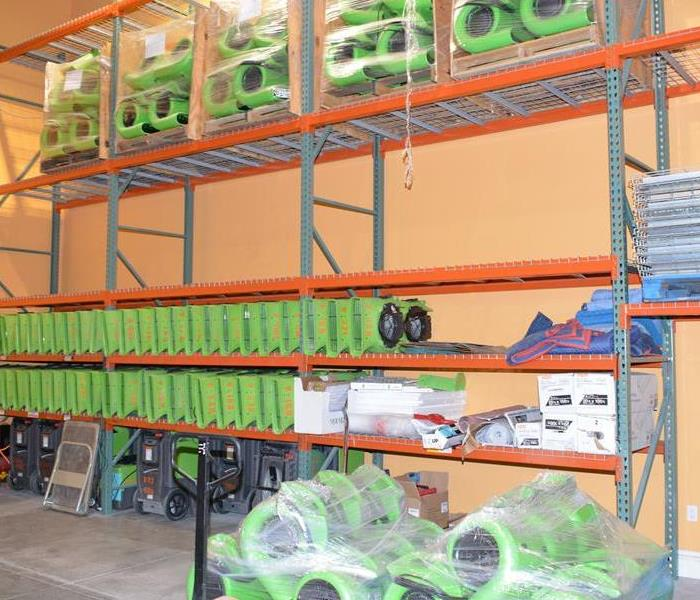 SERVPRO equipment sitting on a set of shelves.