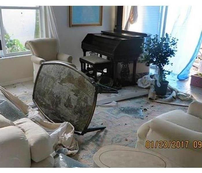 A family room in a home with water damage on the carpet after a storm